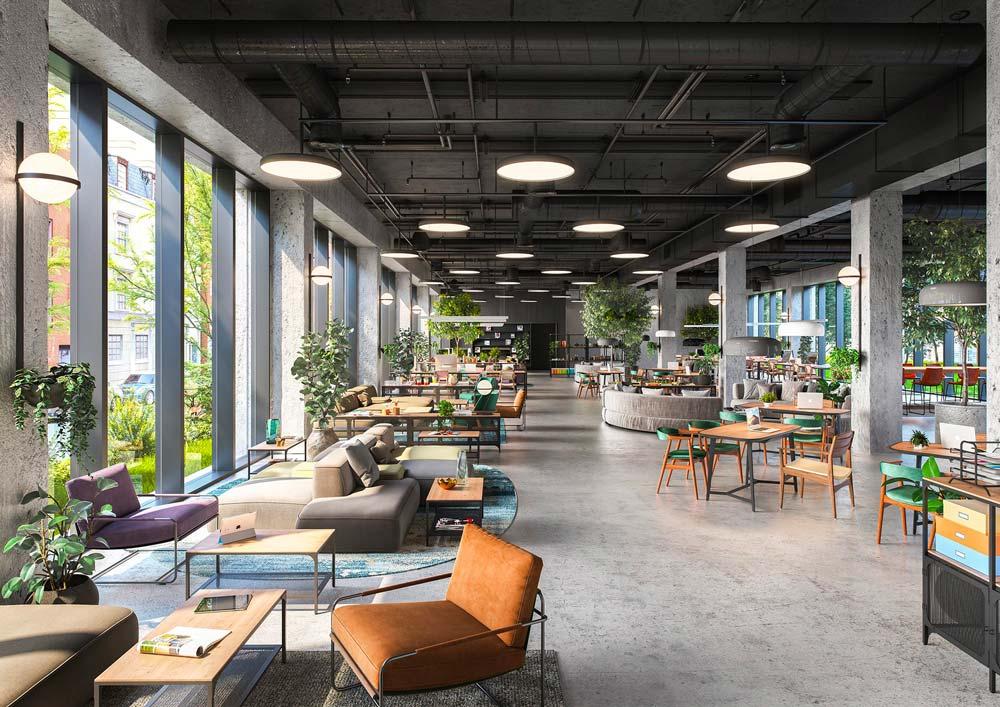 Un grand espace détente de siège social avec de grandes fenêtres, des tables, des canapés et des fauteuils