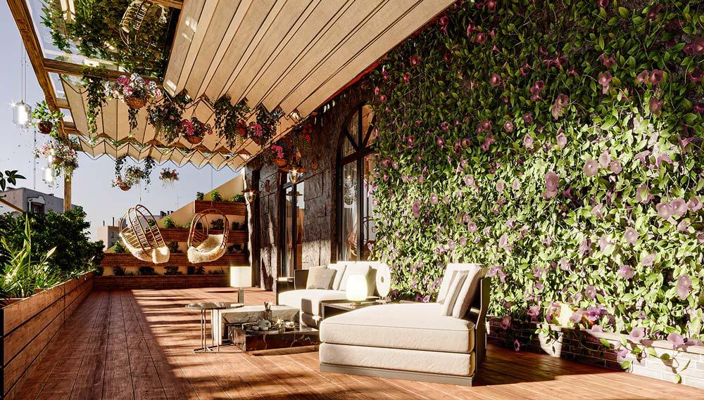 Une grande terrasse en bois avec un mur en pierre, des végétaux et des fauteuils confortables