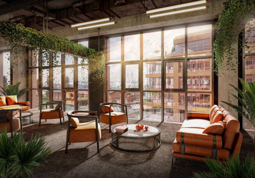 Un espace de coworking avec des murs en béton, de grandes fenêtres, des suspensions végétales et des assises en cuir