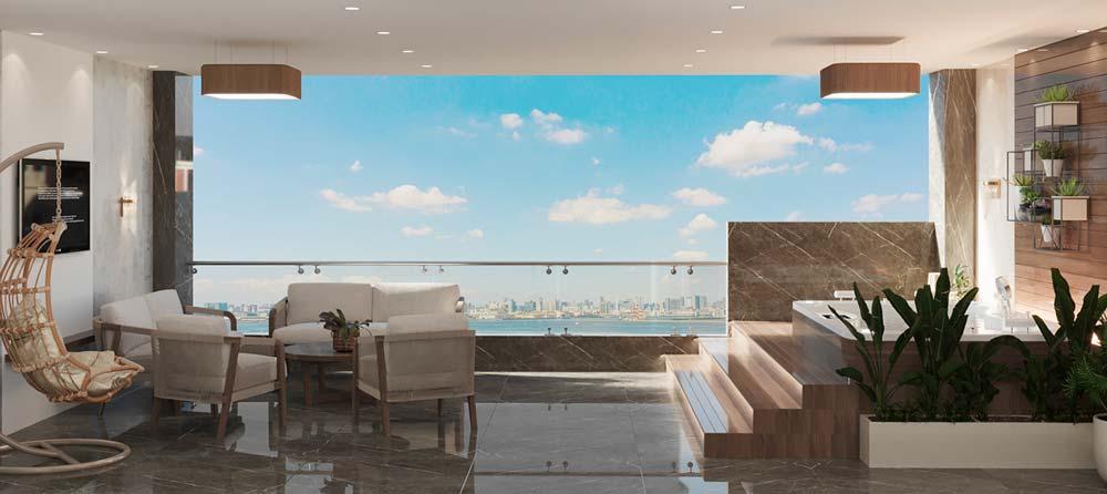 Un grand balcon chic avec un sol en marbre, un jacuzzi et un espace salon avec une télévision