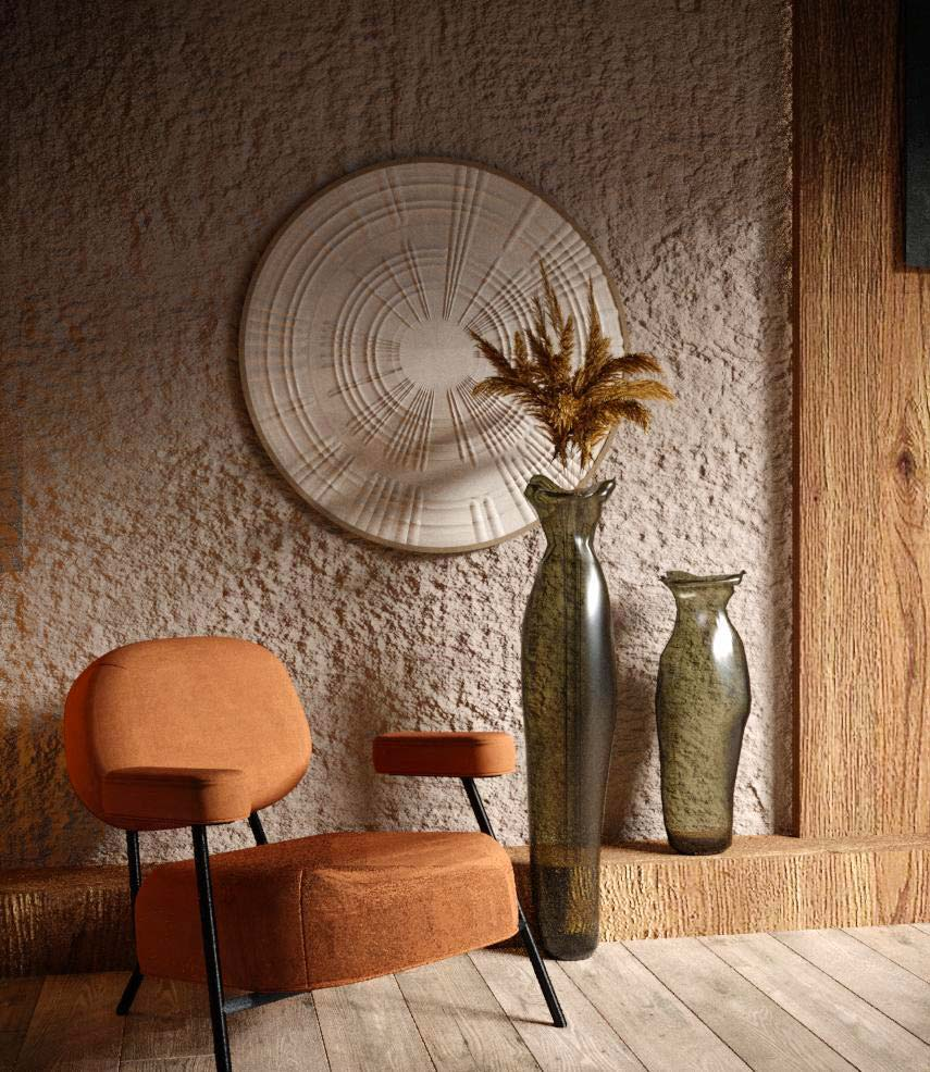 De la petite déco artisanale avec des vases hauts en verre près d'un fauteuil pour un style slow design