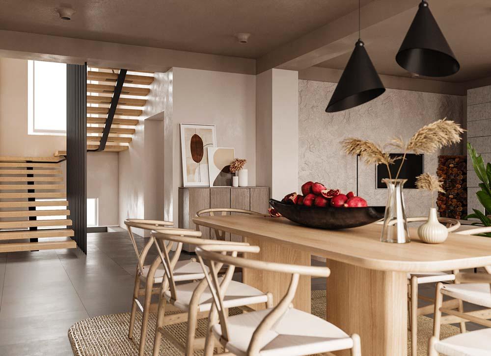 Une salle à manger épurée en bois blond avec un mur de fond en pierre claire