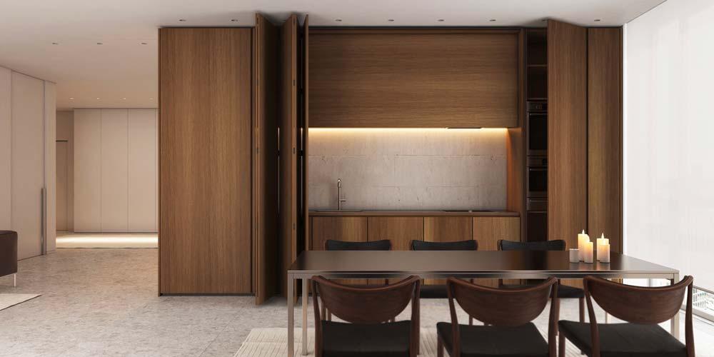 Une salle à manger slow living avec une grande armoire en bois pour un coin cuisine discret