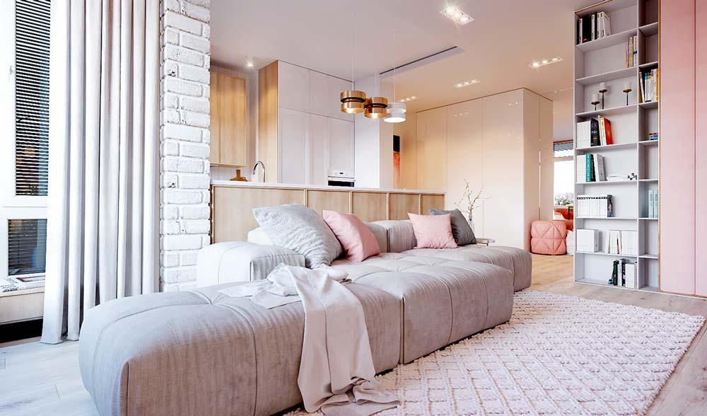 Salon contemporain clair avec des coussins, un pouf et une armoire vieux rose