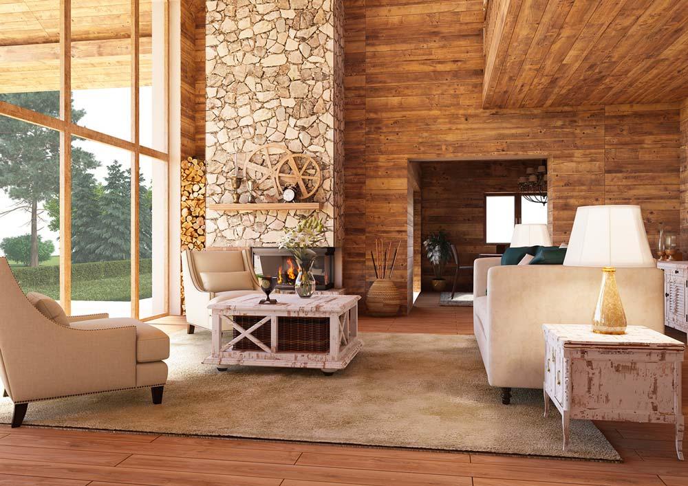 Un salon campagne chic en bois avec un mur en pierre et du mobilier en bois blanc vieilli pour un aspect rustique