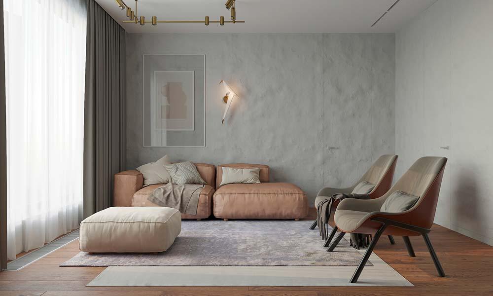 Un salon slow design avec un canapé rose, des fauteuils en cuir et peu de décoration