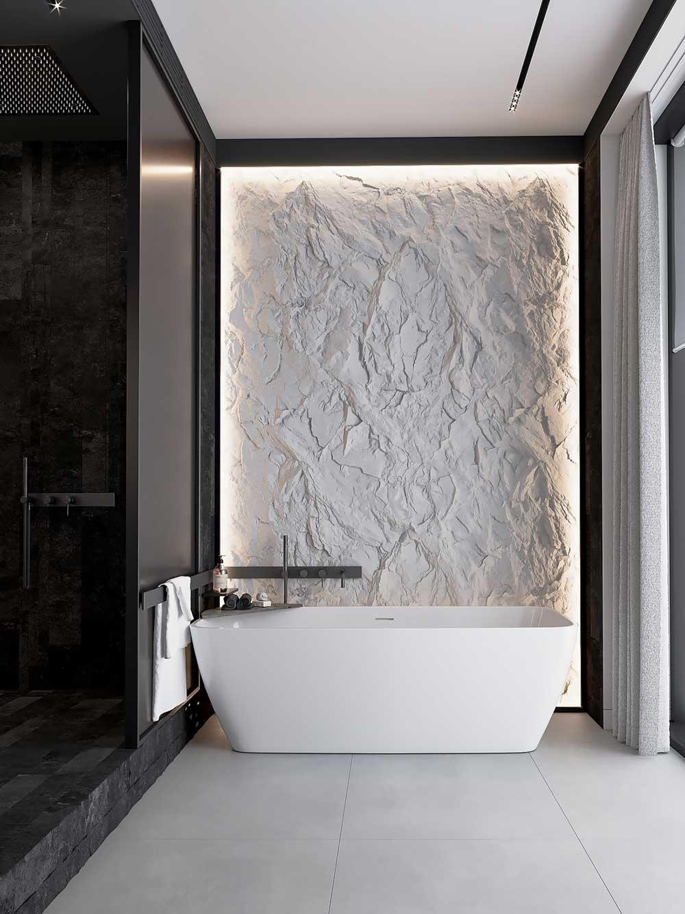 Une baignoire et un mur de pierre blancs avec une douche à l'italienne noire