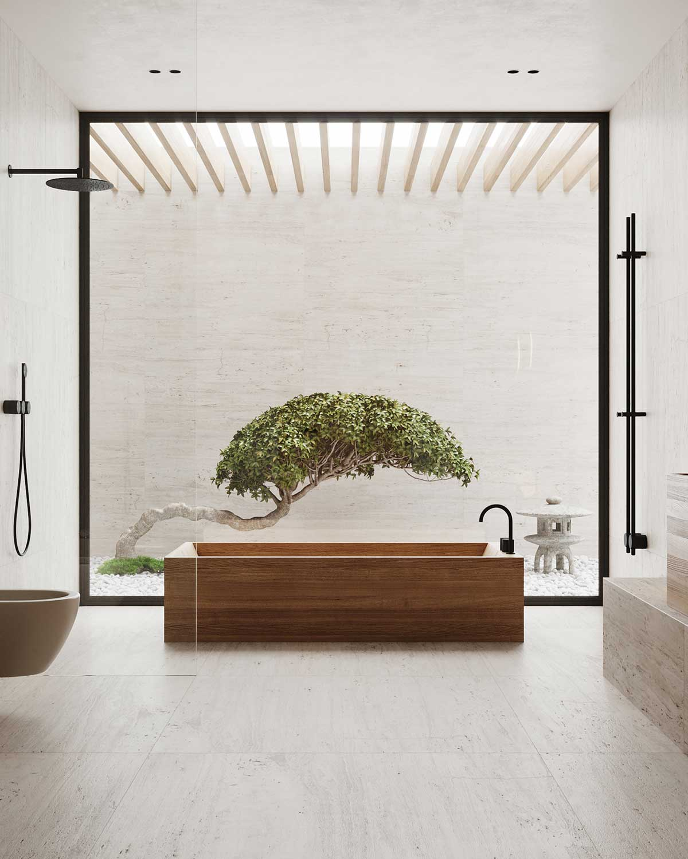 Une grande baignoire en bois dans une salle de bain blanche, devant une baie vitrée qui donne sur un jardin japonais intérieur