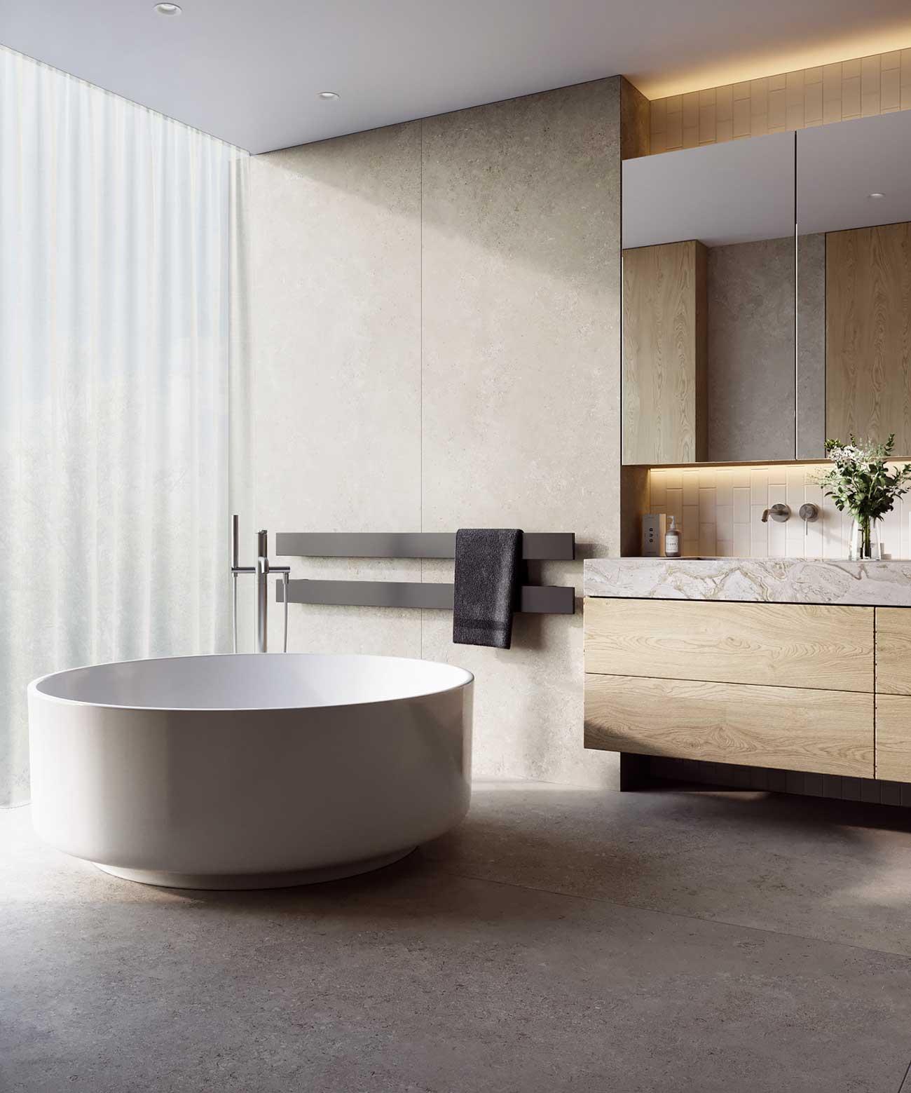 Une salle de bain avec une baignoire ronde , des murs clairs et des meubles en bois blond