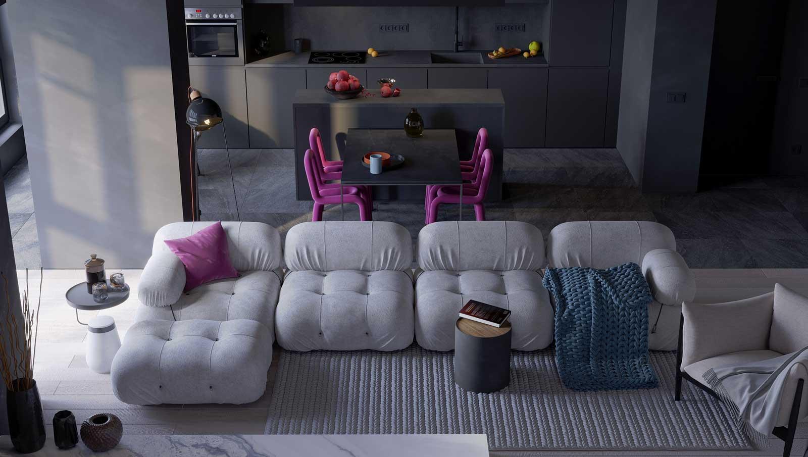 Les canapés modulables aux formes arrondies s'intègrent à un coin salon cuisine avec des meubles sombres, une table et des chaises en tube rose