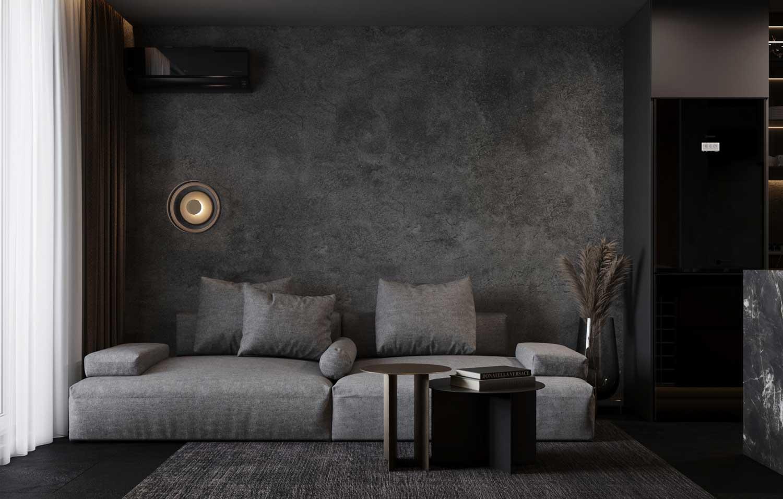 Un canapé modulable gris dans un salon monochrome design éclairé par une grande fenêtre