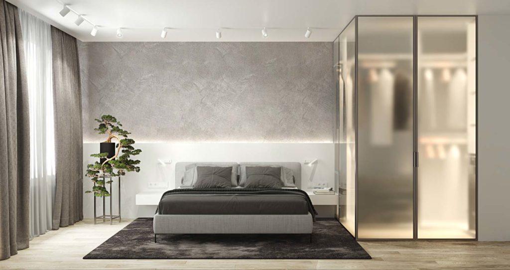 Une chambre claire au mur bicolore blanc et pierre grise avec un dressing vitré