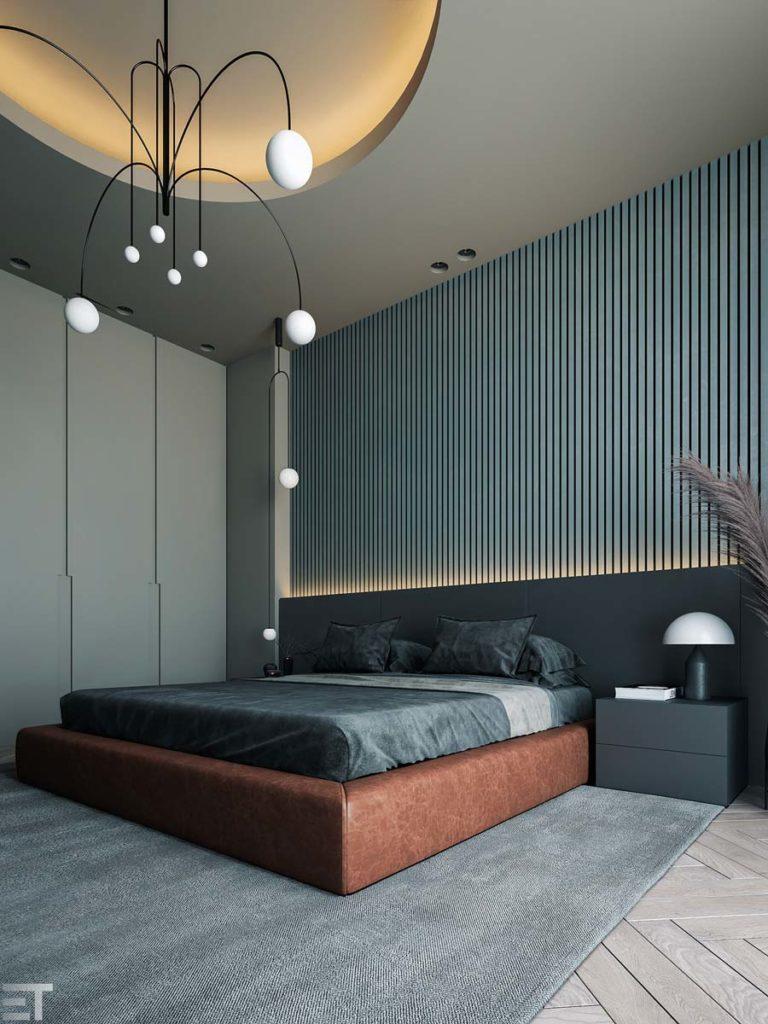 Une chambre grise et blue sky avec un lit double et une tête de lit en bardage intérieur bleu clair