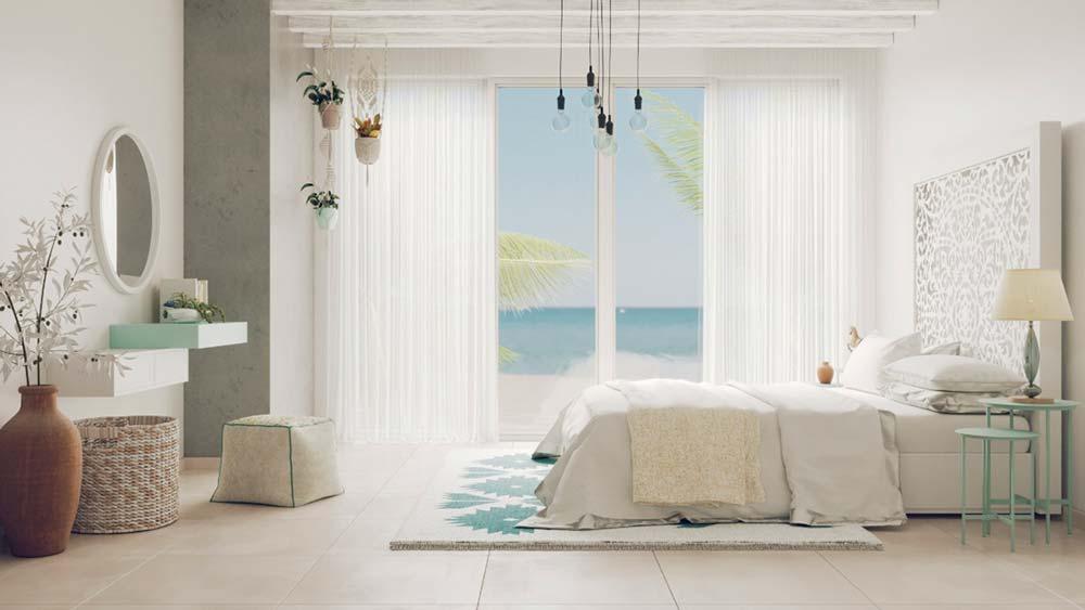 Une chambre parentale blanche avec une tête de lit décorée d'un grand mandala gris et blanc et une immense baie vitrée