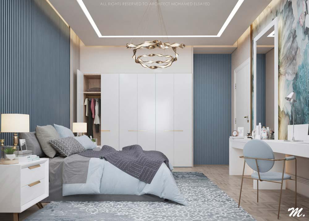 Une chambre parentale blanche et blue sky avec un grand tapis