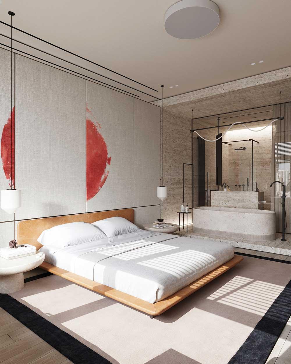 Une suite parentale avec un grand lit et un espace salle de bain en pierre