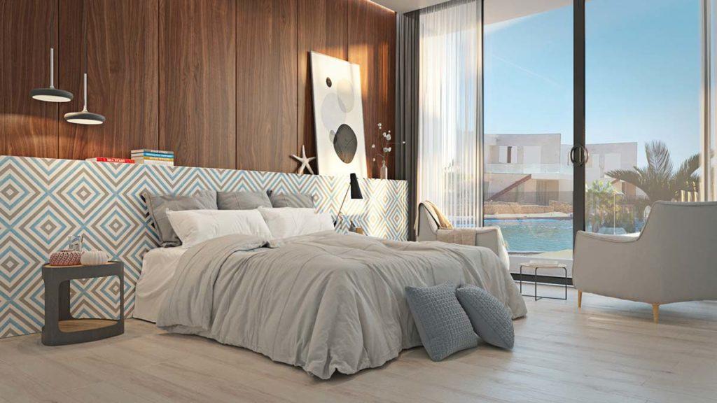 Des essences de bois brun et blond sur le mur et le sol d'une chambre parentale au linge de lit gris et blanc