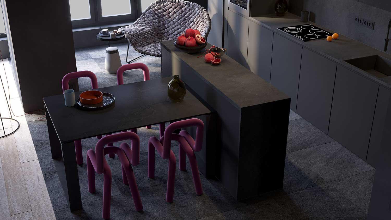 Des chaises en tube rose dans une cuisine look total black