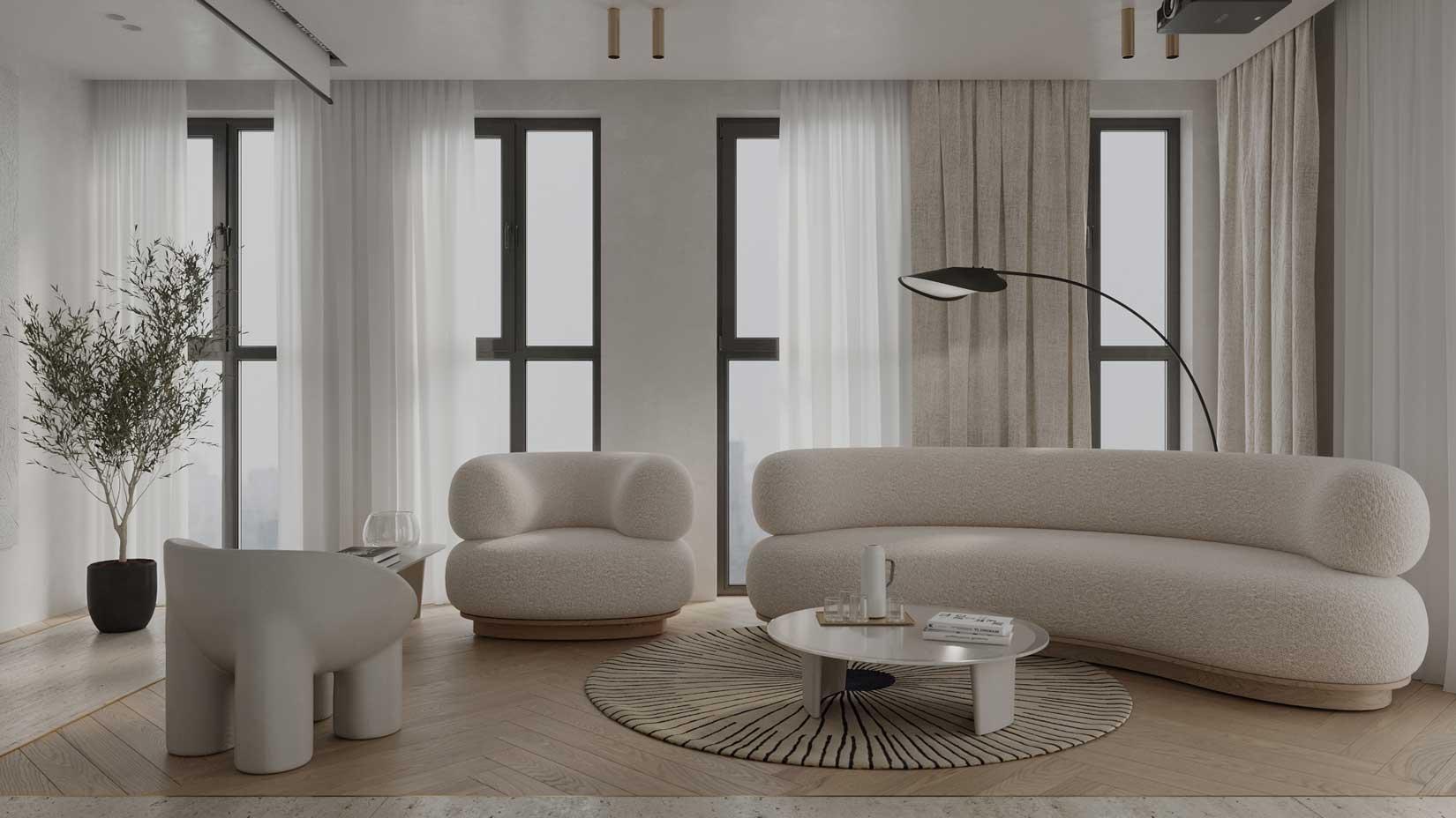 Le tube épais en laine bouclé se retrouve dans les fauteuils et canapés d'un salon blanc accueillant