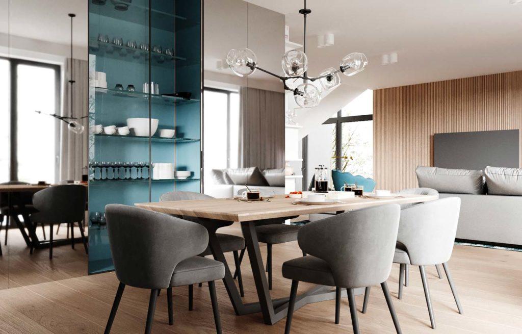 Un grand salon et salle à manger avec table et chaise, canapé et télévision sur un mur en bardage intérieur en bois, et une armoire vitrée centrale au fond couleur blue sky