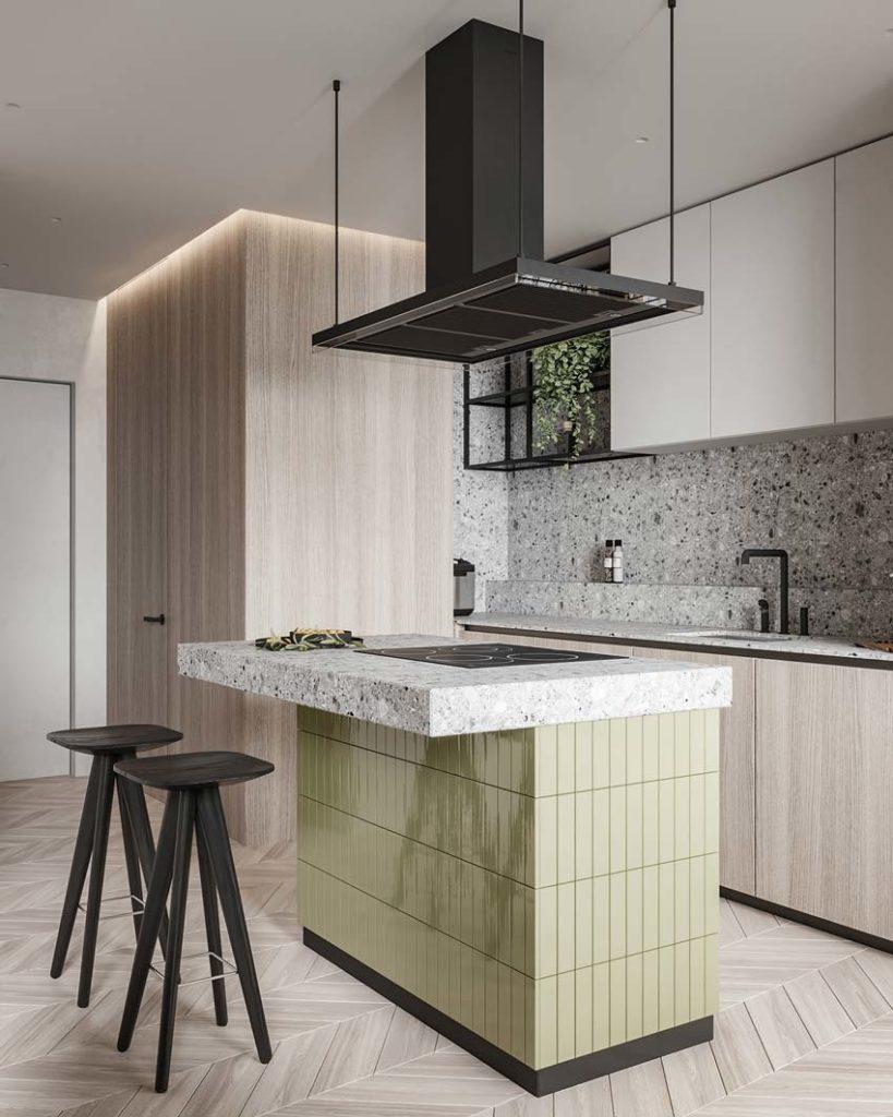 Cuisine en bois et terrazzo gris avec un plancher en chevrons et un îlot central en zellige rectangulaire vert pâle
