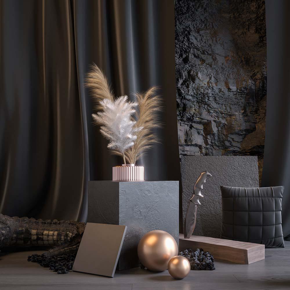 Un coin déco avec des rideaux sombres sur un mur en pierre, des coussins et des accessoires gris et dorés