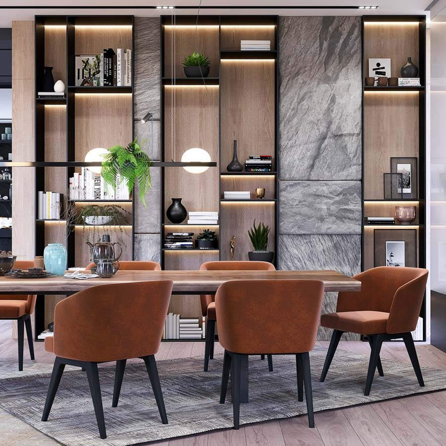 Une salle à manger avec un mur en pierre et des étagères décoratives noires en bois blond