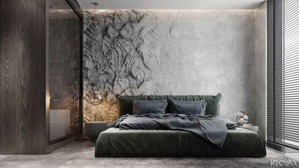 Une tête de lit en pierre texturée dans une chambre grise avec un lit kaki et une grande fenêtre