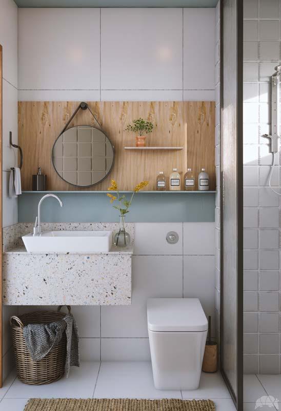 Une salle de bain lumineuse blanche avec des touches de bois clair et une petite bande de peinture blue sky