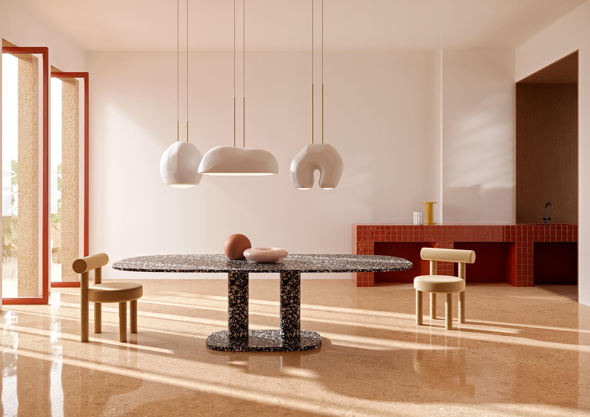 Le tube décore un intérieur atypique avec des pieds de table en terrazzo et des sièges