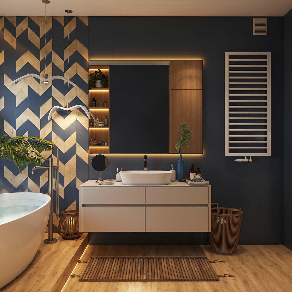 Une salle de bain aux murs bleu et blanc, avec un plancher en bois, une baignoire et des luminaires en forme de mouettes