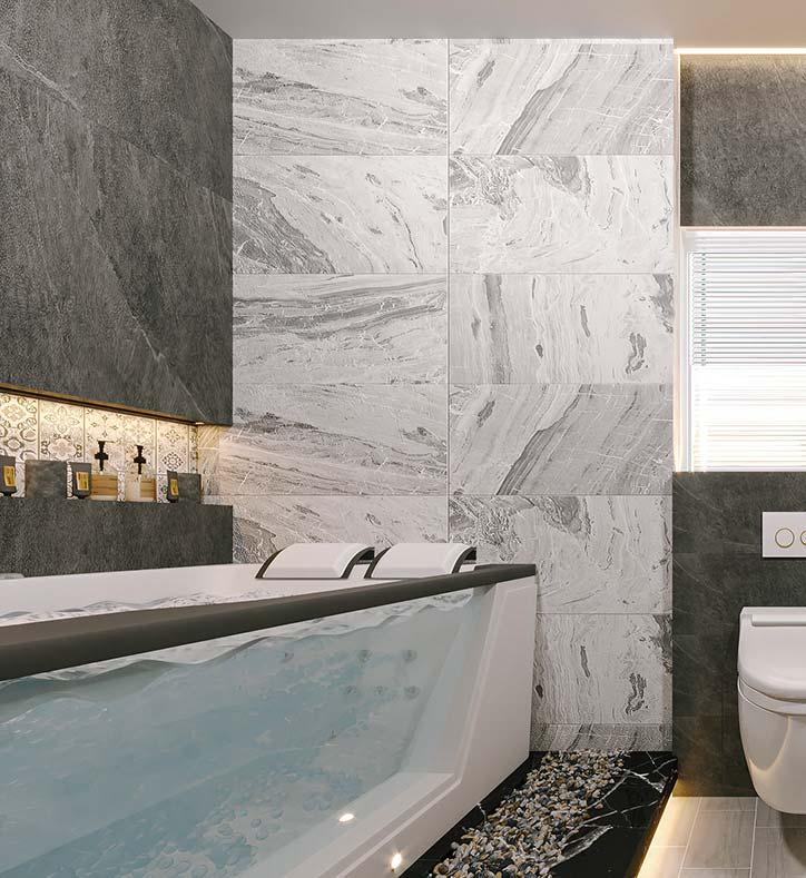 Une salle de bain moderne avec du carrelage mural gris et blanc aux effets de rides de courant et une grande baignoire transparente