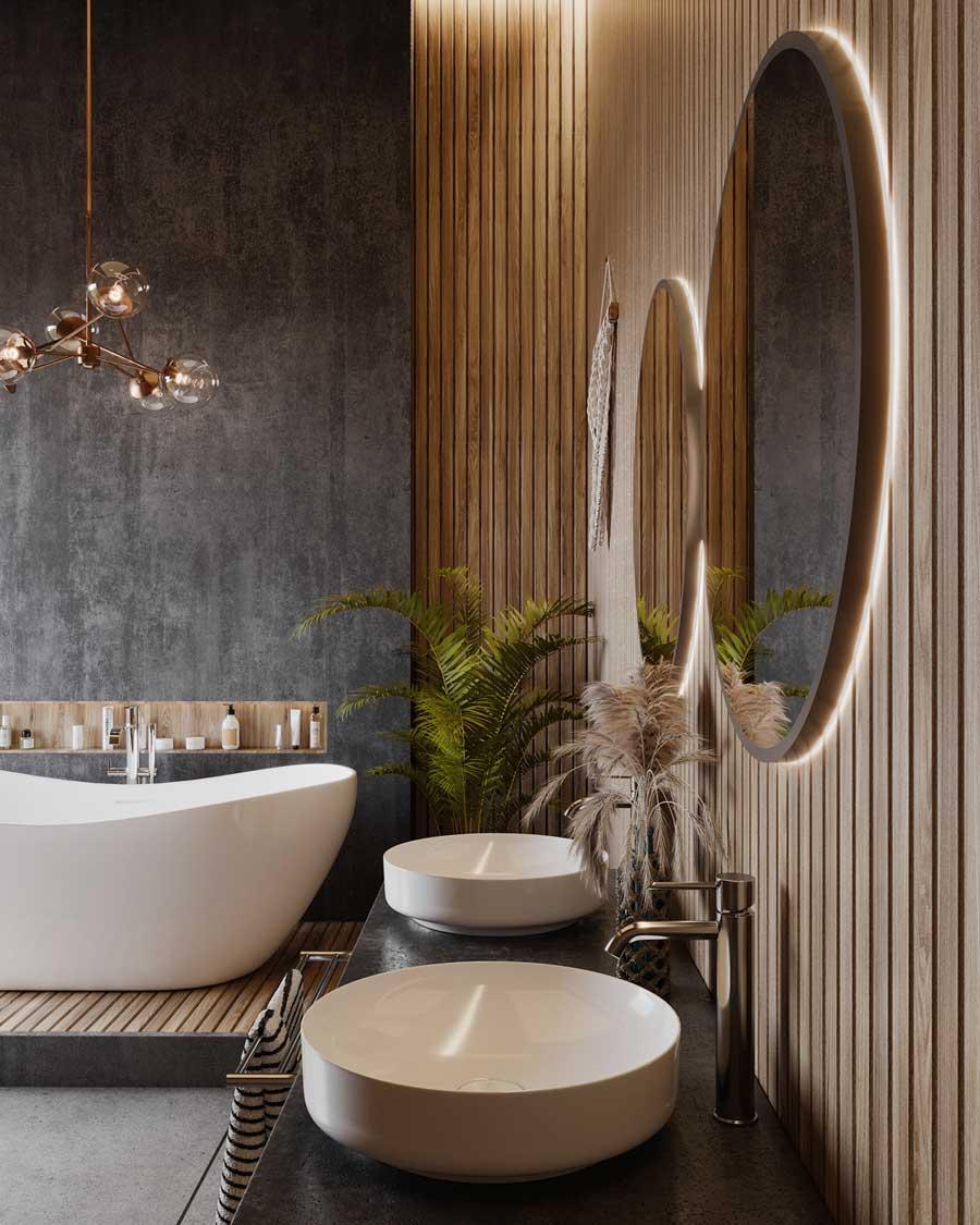 Une salle de bain ambiance spa avec du bardage intérieur en bois, un mur en ardoise, une baignoire blanche et des grands miroirs ovales