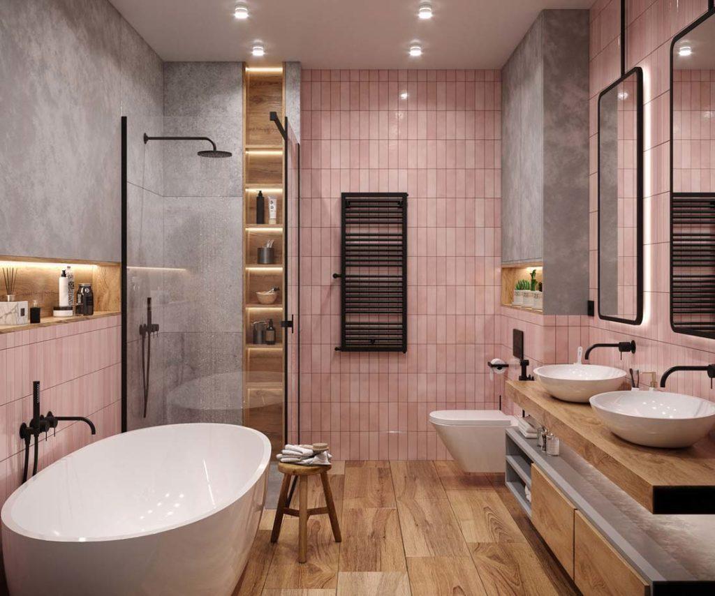 Une salle de bain avec des murs en zellige rose, un plancher, des meubles en bois, du revêtement gris imitation béton et de la robinetterie noire