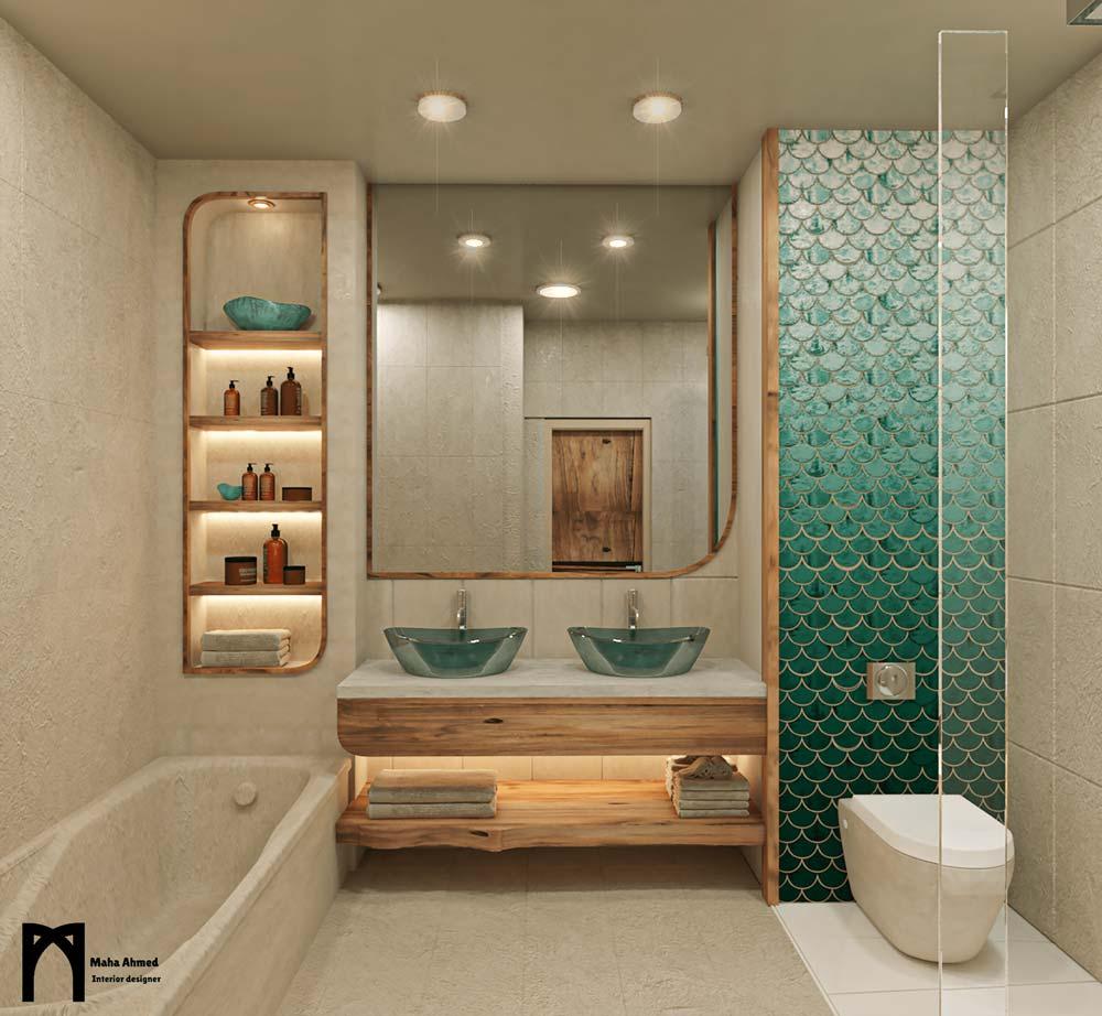 Un bout de mur en zellige écailles de poisson turquoise dans une salle de bain à l'ambiance bord de mer avec des meubles en bois
