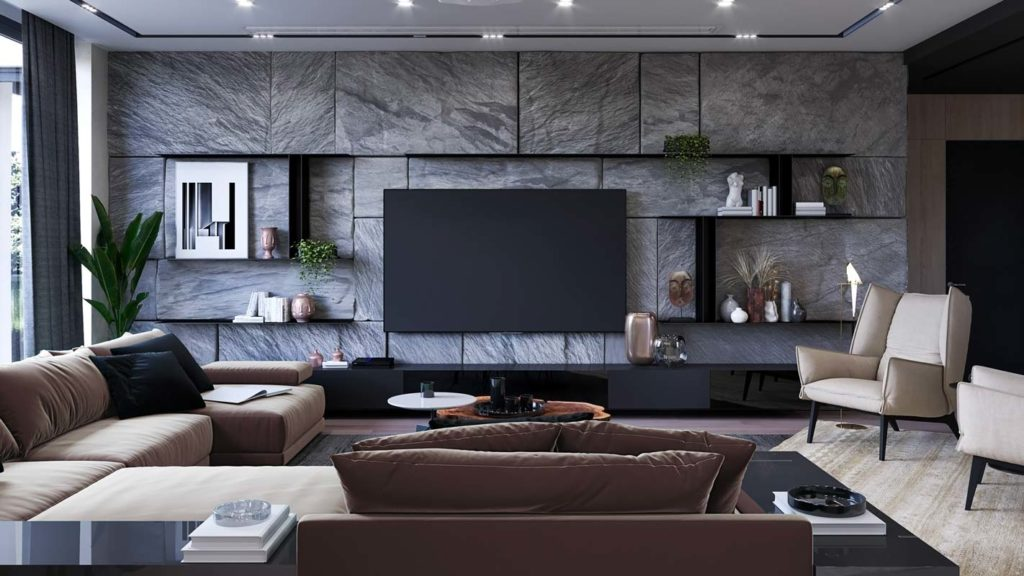 Un mur de pierre au salon sur lequel sont placées des étagères de rangement noires et discrètes