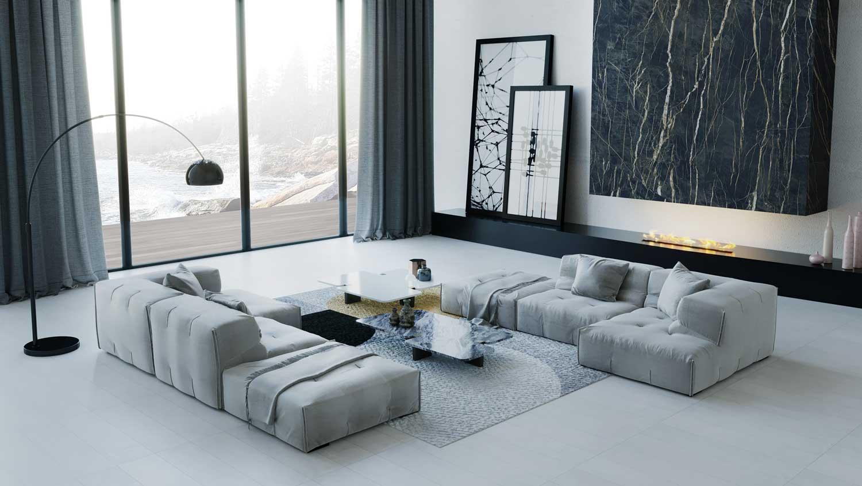 Un grand canapé modulable blanc qui créé un espace convivial dans un grand salon blanc et noir moderne et design