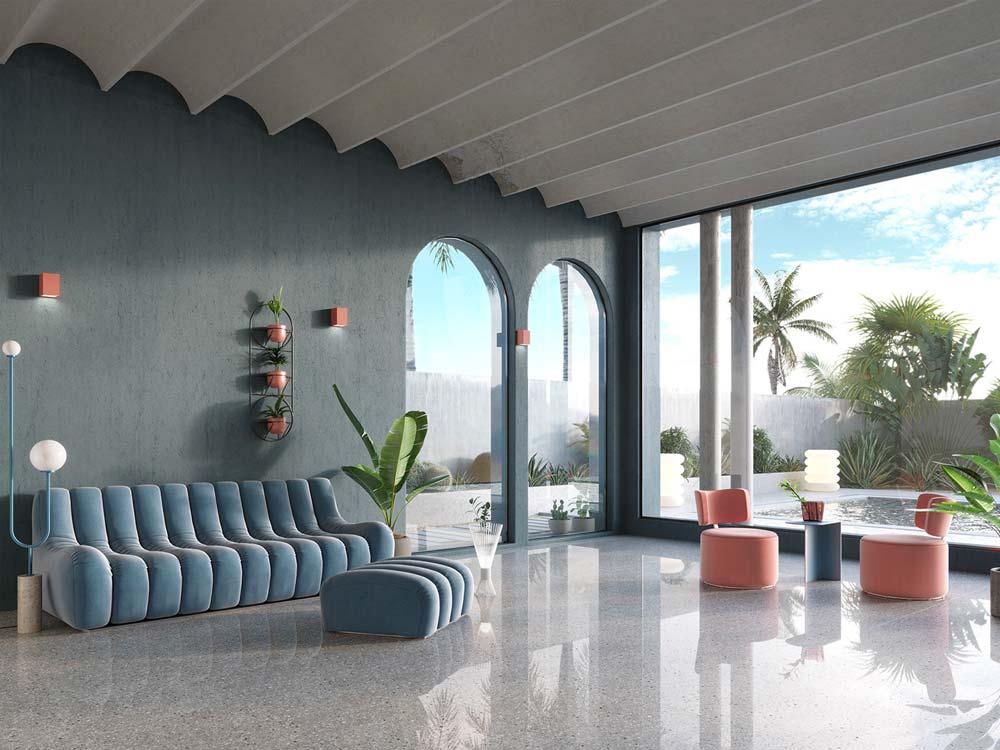 Un grand salon ouvert sur l'extérieur avec des canapés et des poufs arrondis de couleur blue sky et rose corail