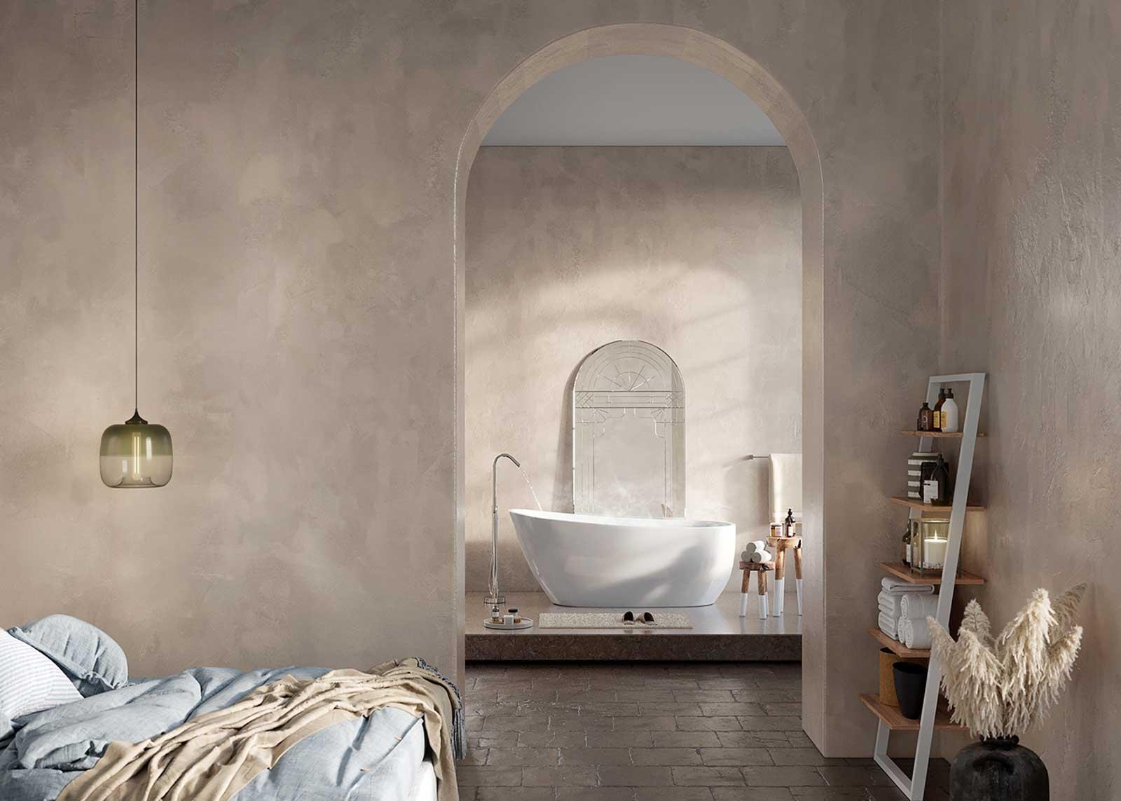 Une suite parentale en teintes douces avec un espace bain éclairé et surélevé