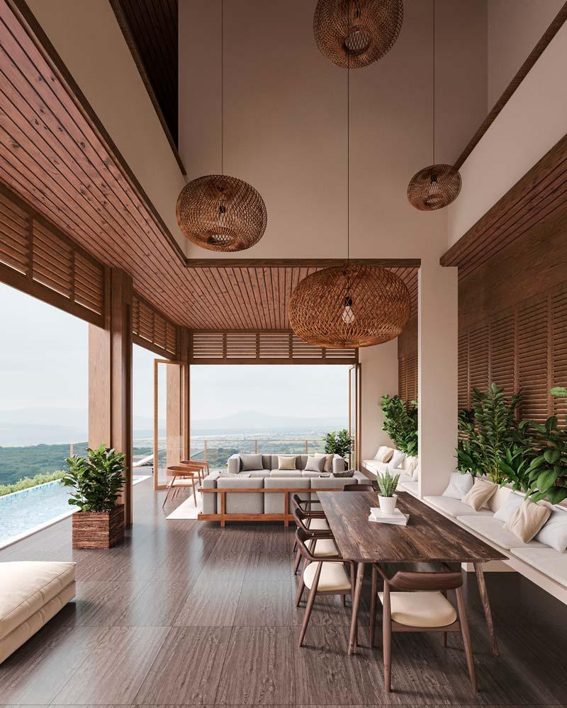Un salon de jardin extérieur sur une grande terrasse en bois