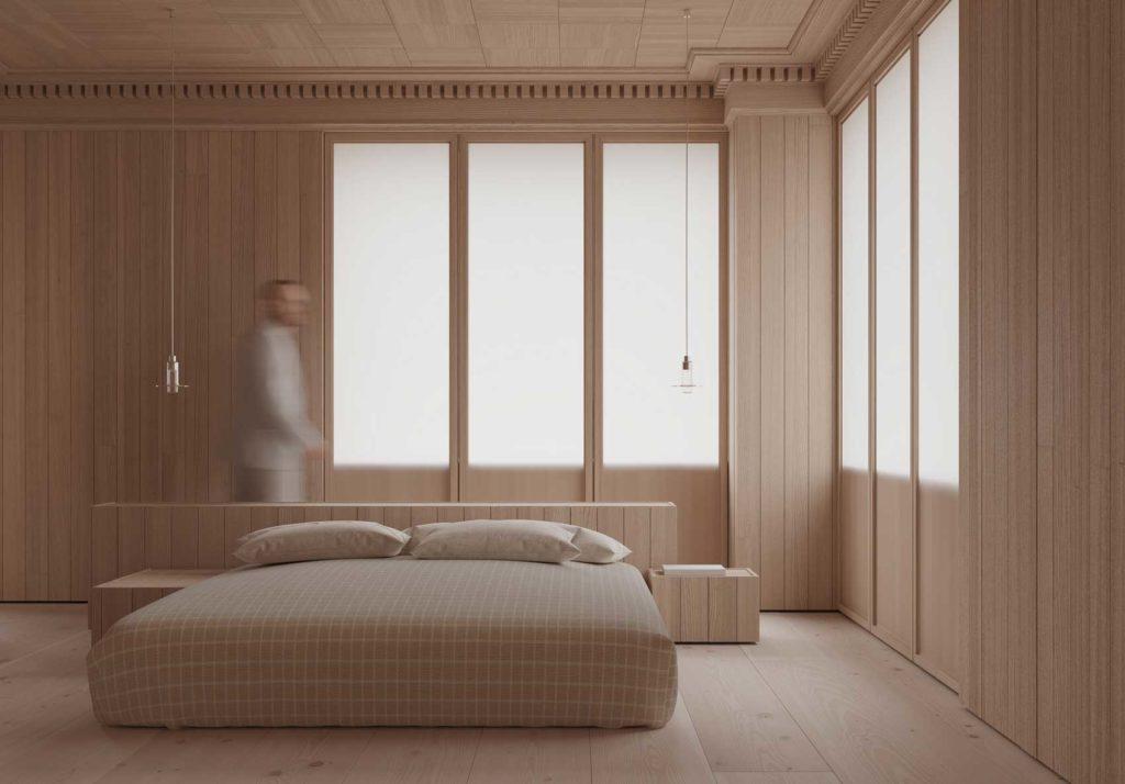 Une chambre entièrement en bois blond avec un grand lit central