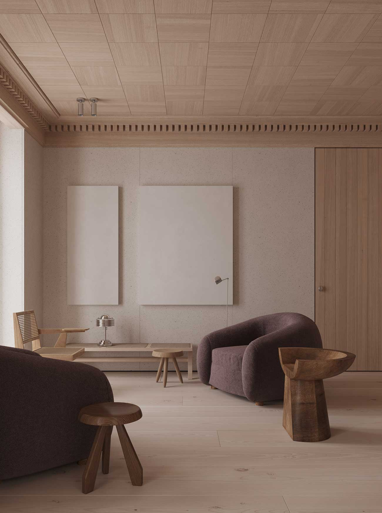 Des fauteuils en velours dans un salon chic avec du bois blond au plafond