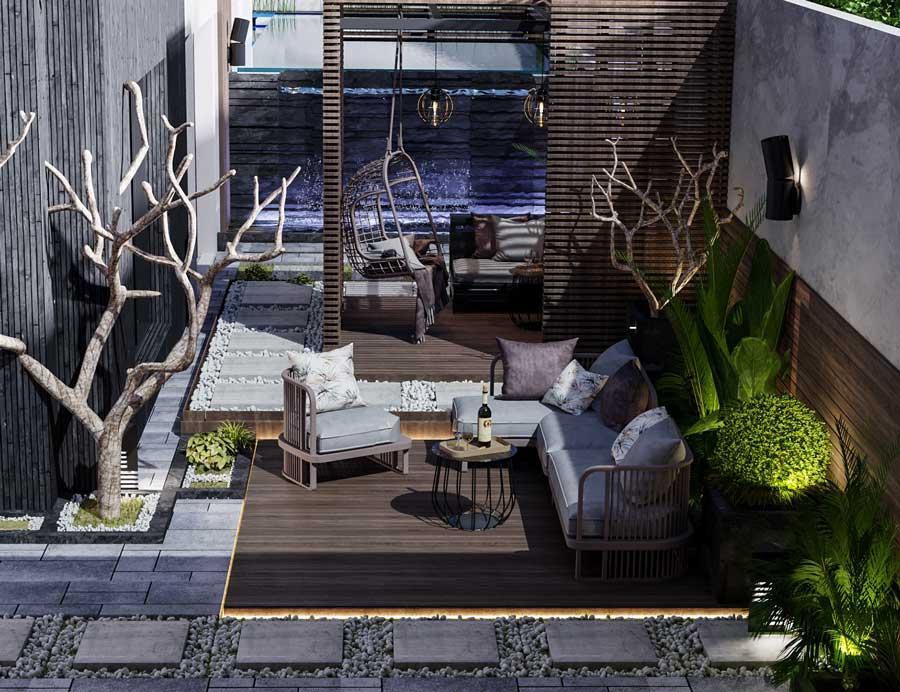 Les bois sombre et brûlé décorent une terrasse avec des salons de jardin tendance éclairés par des néons