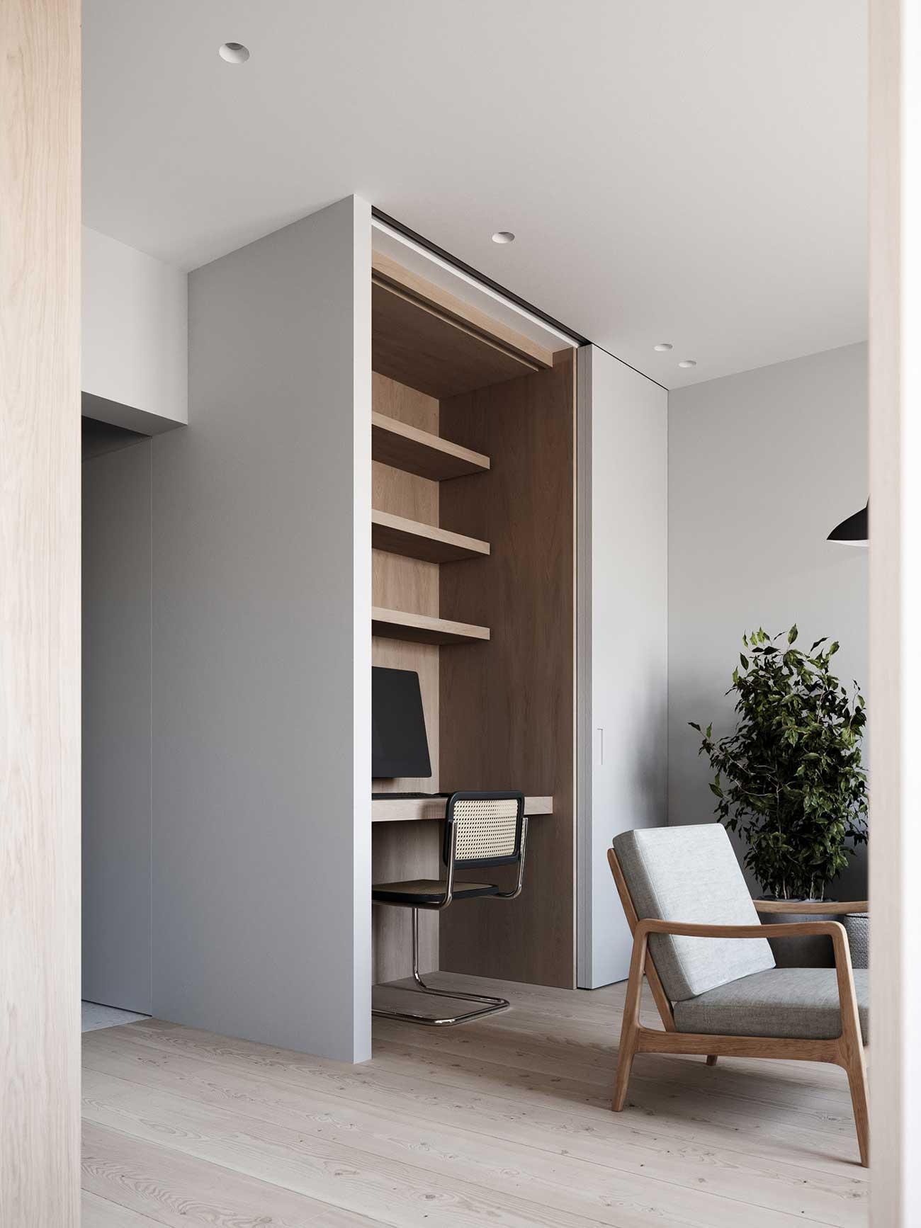 Un espace minimaliste où le bureau est situé dans une armoire à portes coulissantes