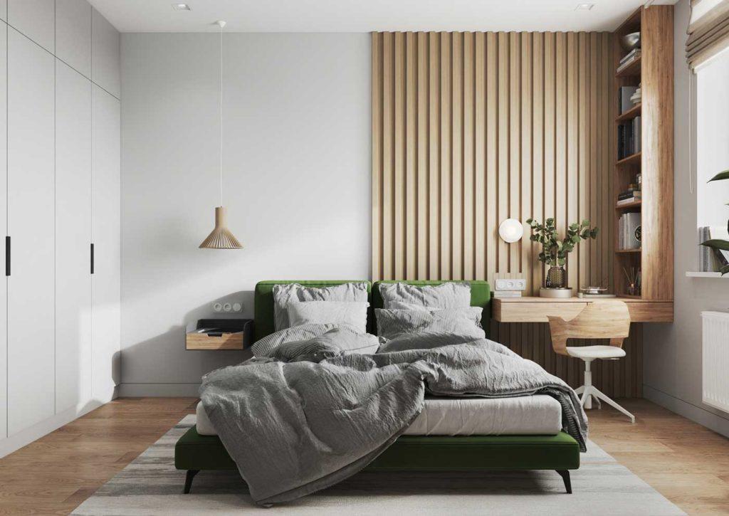Une chambre lumineuse en bois blond, blanc et vert émeraude avec un coin bureau