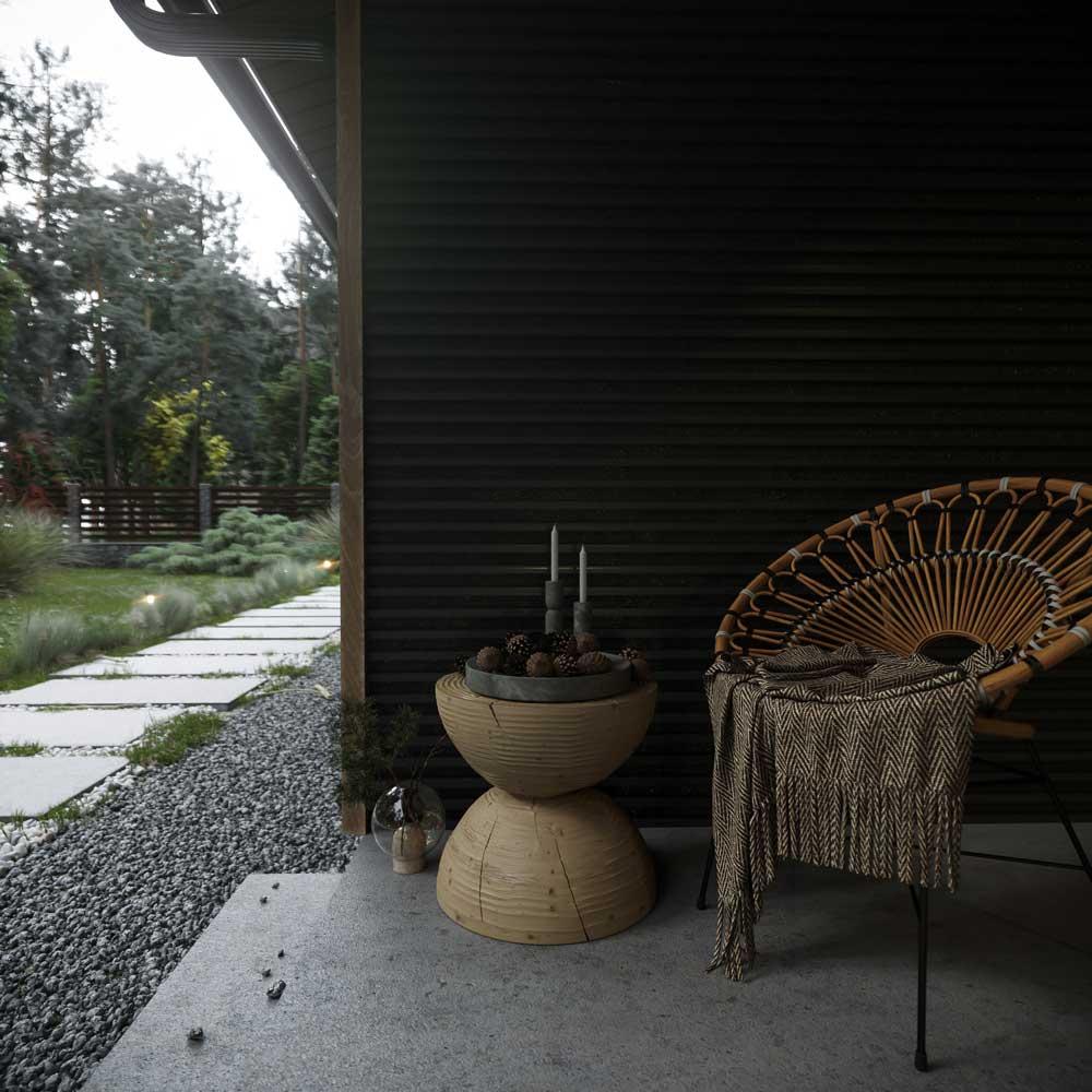Le mobilier de jardin sert pour créer un coin lecture cocooning avec un fauteuil en corde et un guéridon
