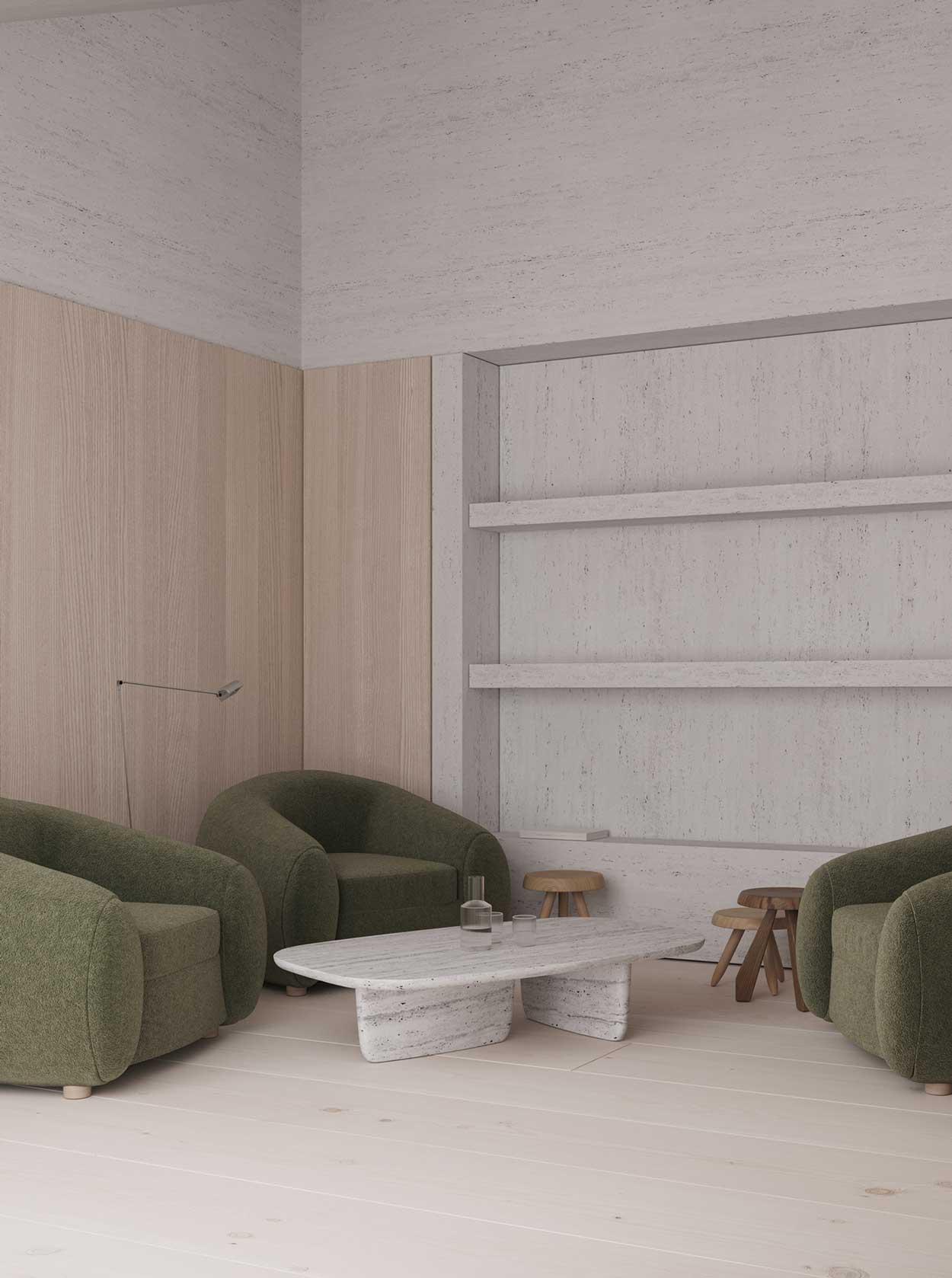 Un coin salon en bois blond et béton blanc avec des fauteuils en velours