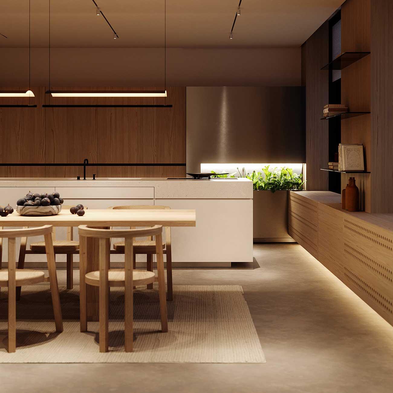 Une cuisine en bois blond vue de nuit avec des meubles et de la végétation rétroéclairés