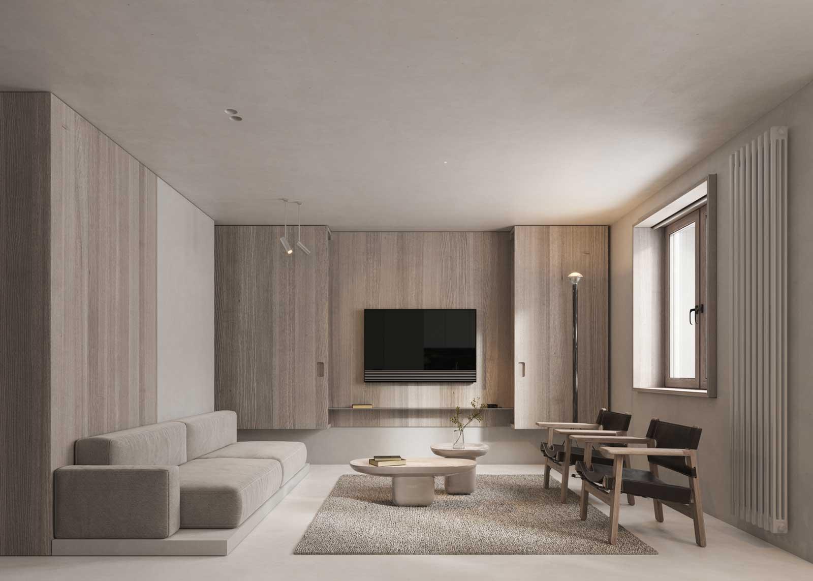 Dans un salon, une grande armoire murale fait office de meuble télé lorsque ses portes sont ouvertes