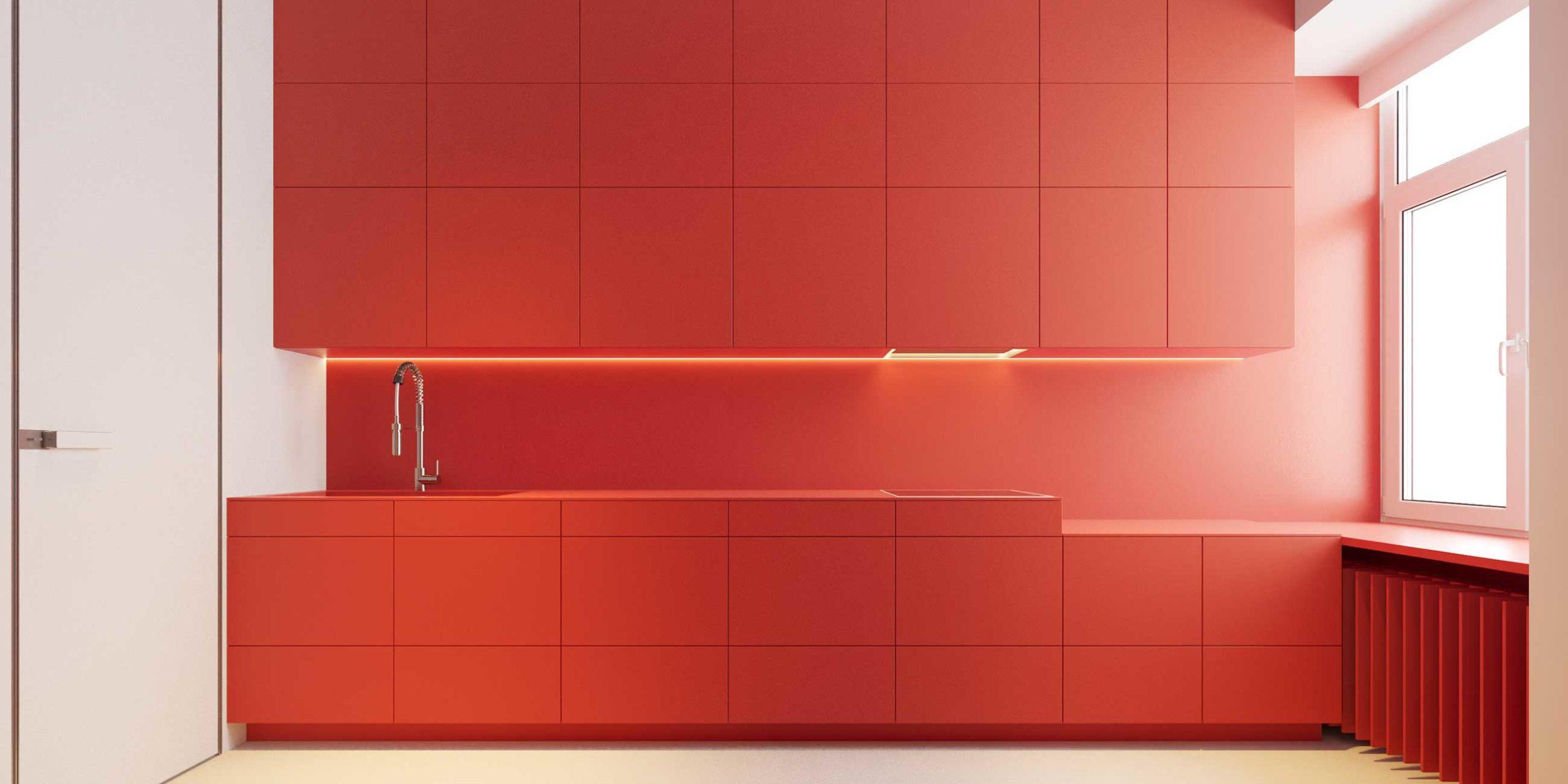 Une cuisine minimaliste dotée de nombreux rangements avec des couleurs vives